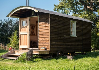 Stay in one of our Huts at Wilderness Wood this Summer